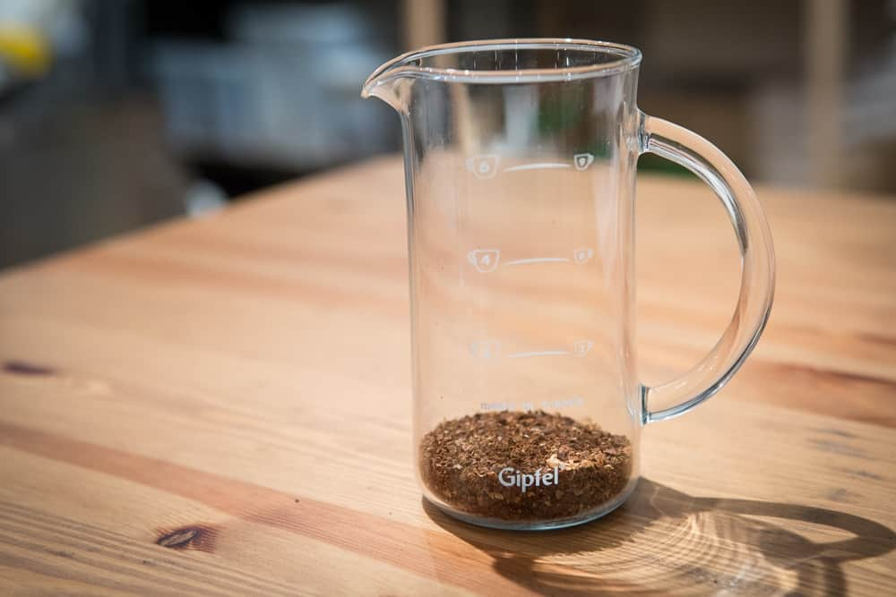 How to make French Press Coffee - Step 2: Add your coffee - CoffeeHow.co