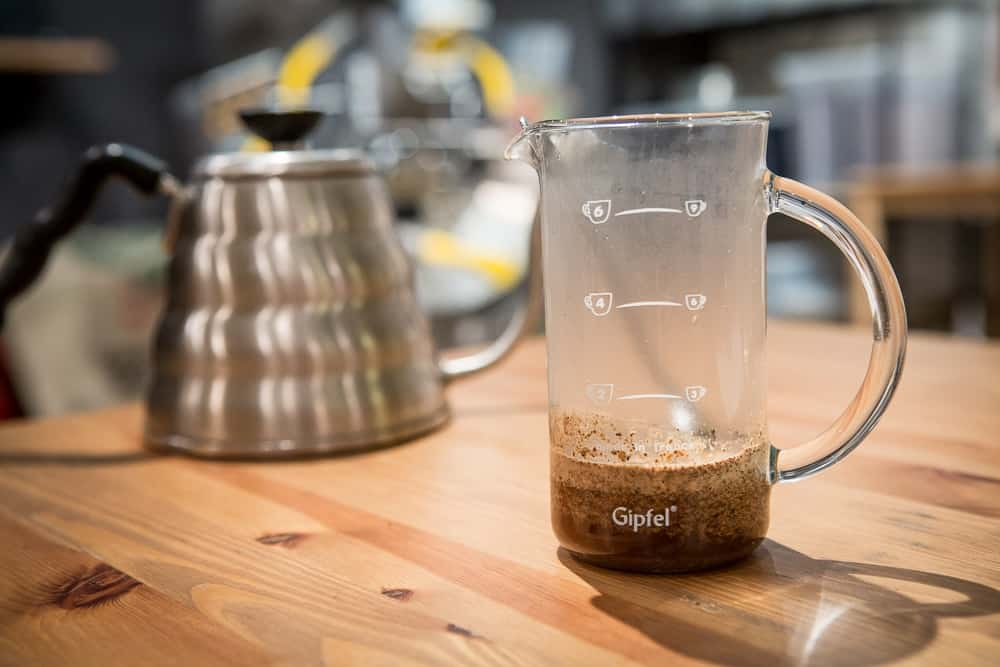 How to make French Press Coffee - Step 3: Add water - CoffeeHow.co