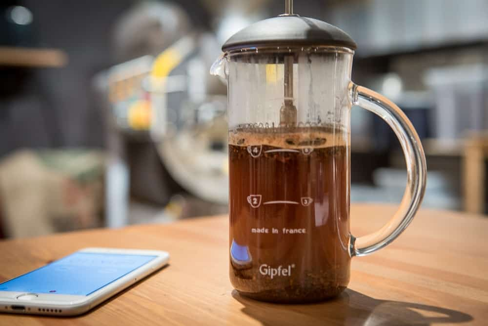How to make French Press Coffee - Step 5: Add more water - CoffeeHow.co