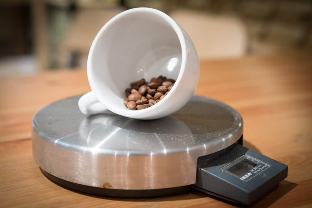 How to make Pour Over Coffee - Step 4: Weigh Coffee - CoffeeHow.co