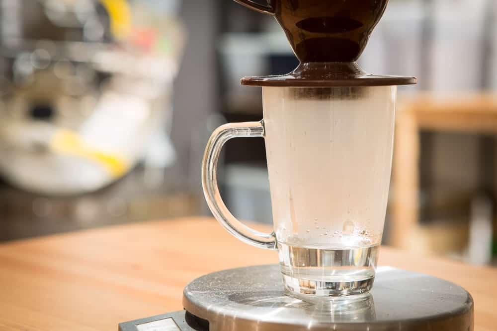 How to make Pour Over Coffee - Step 2: Place and Rinse Filter - CoffeeHow.co